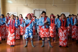 A group of Pacific children performing a traditional dance.