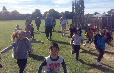 Students from Te Pa o Rākaihautū running across a playground.