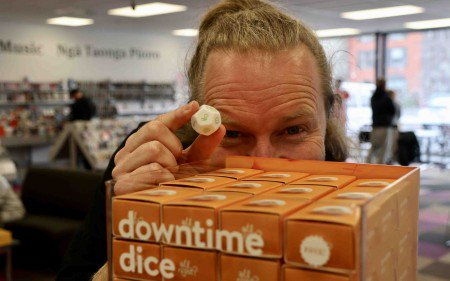 All Right? mental health strategist Ciaran Fox with a dice at Central Library. Source: Christchurch City Council.